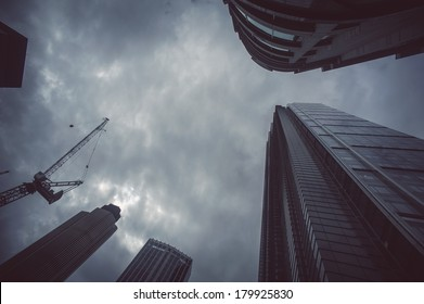 Skyscrapers from below with dramatic sky