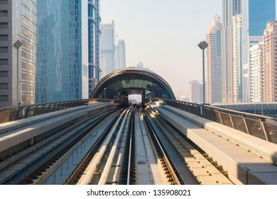 skyscrapers business center on blue sky background and Metro Train in Dubai, United Arab Emirates