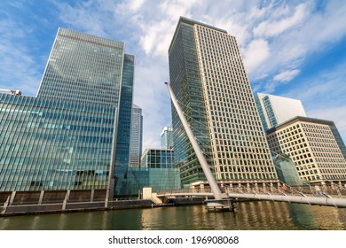 Skyscrapers at Canary Wharf with bridge in the foreground. Docklands, London, England, Europe