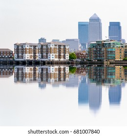 Skyscrapers in Canary Wharf, a major financial district in London, and their reflections from Thames river