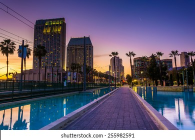 Skyscrapers and the Children's Pond at sunset, in San Diego, California.