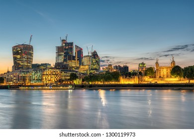 The skyscrapers of the City and the Tower of London after sunset