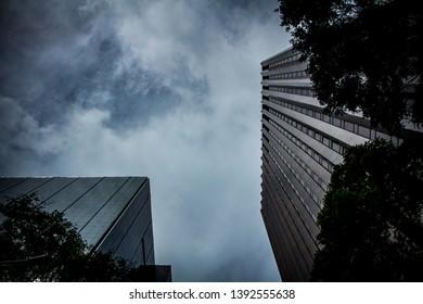 skyscrapers in cloudy dark skys