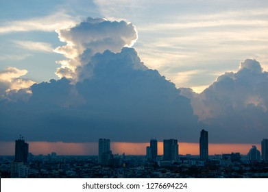 The skyscrapers in downtown Bangkok cityscapes, the capital of Thailand in southeast Asia, with rain cloud and sunset in horizontal view.