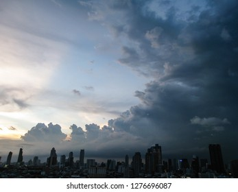 The skyscrapers in downtown Bangkok cityscapes, the capital of Thailand in southeast Asia, with rain cloud in horizontal view.