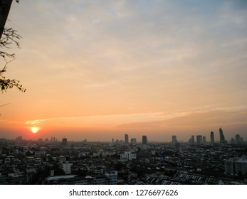 The skyscrapers in downtown Bangkok cityscapes, the capital of Thailand in southeast Asia, with sunset in winter in horizontal view.