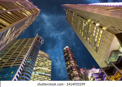 Skyscrapers in downtown core of Singapore looking up at night
