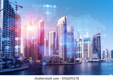 Skyscrapers of Dubai business downtown. International hub of trading and financial services. Social network icons hologram, concept of human resources. Double exposure. Dubai Canal waterfront.