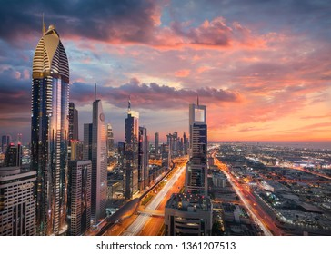 Skyscrapers of Dubai downtown with modern subway and highway infrastructure at beautiful sunset known as business district.