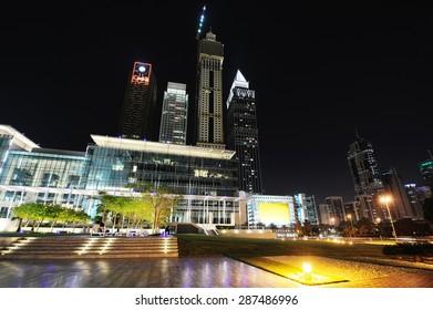 Skyscrapers of Dubai World Trade center at night.