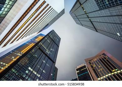 skyscrapers face to face at dusk in Hong Kong of China.
