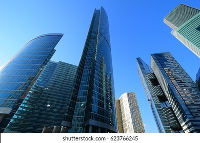 Skyscrapers in the financial district of Moscow. Wide angle shot from the bottom up at the blue sky background. Business, financial, real estate background.