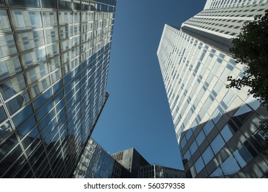 5aa7bbda1f1f Skyscrapers with glass facade. Modern buildings in Paris business district.  Concepts of economics
