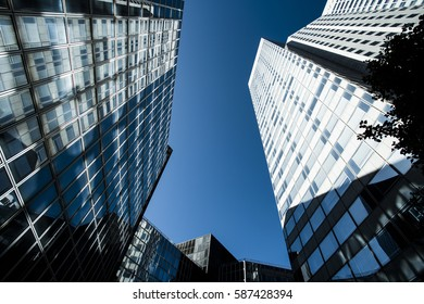 Skyscrapers with glass facade. Modern buildings in Paris business district. Concepts of economics, financial, future.  Copy space for text. Dynamic composition. Toned