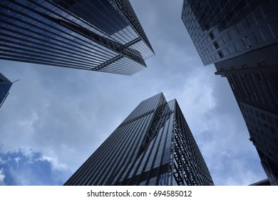 Skyscrapers with glass facades and blue sky in Hong Kong, China