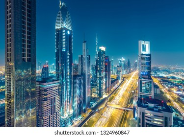 Skyscrapers and highways in downtown Dubai, UAE.  Nighttime skyline of a big modern city.
