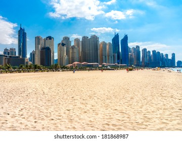 Skyscrapers and jumeirah beach in Dubai Marina. UAE