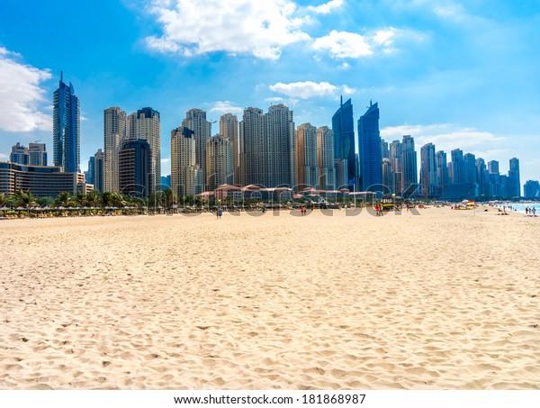 Skyscrapers and jumeirah beach in Dubai Marina. UAE