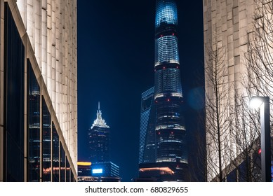 Skyscrapers from a low angle view at night in city of China.