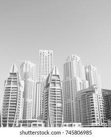 Skyscrapers at the Marina in Dubai against the Blue Sky in Black and White