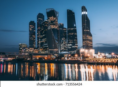 Skyscrapers of Moscow City business center and Moscow river in Moscow at night, Russia.  Architecture and landmark of Moscow