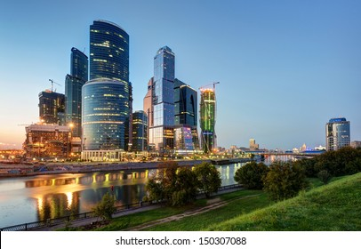 Skyscrapers of Moscow-City at the Moskva River at night, Russia. Moscow-City is a new business district in Moscow centre. Beautiful panorama of modern buildings at dusk. Cityscape of Moscow in summer.