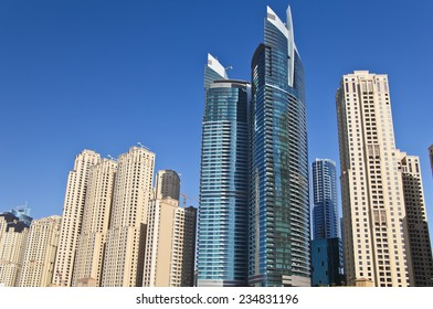 Skyscrapers on the background of the blue sky on sunny day.
