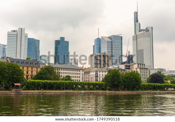 Skyscrapers on a background of the cloudy sky. Architecture in Frankfurt am Main. Panorama of the city. Glass buildings.