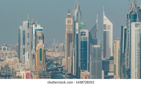 Skyscrapers on Sheikh Zayed Road and DIFC aerial timelapse in Dubai, UAE. Traffic on a highway near Financial Centre at evening before sunset