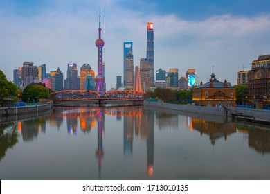 The skyscrapers in Pudong, the skyline of Shanghai, shot at dawn, with reflection in front.