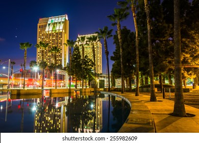 Skyscrapers reflecting in the Children's Pond at night, in San Diego, California.