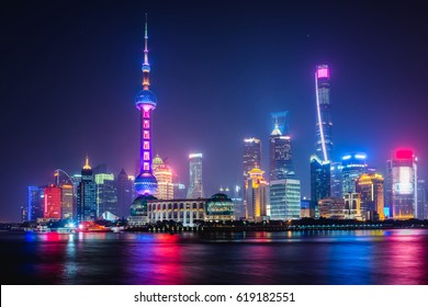 The skyscrapers of Shanghai lit up at night along the Bund.