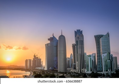 The skyscrapers in the skyline of the commercial center of Doha, the capital of the Arabian Gulf country Qatar at sunset.