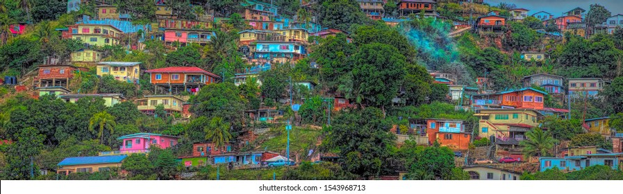From skyscrapers to small houses many of the hills around Port of Spain Trinidad show the color of island architecture