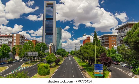 skyscrapers timelapse in the Four Towers Business Area with the tallest skyscrapers in Madrid and Spain from the bridge over the road with traffic -Torre Espacio, Torre de Cristal, Torre PwC and Torre