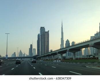 Skyscrapers view on the sunrise highway road in Dubai, UAE