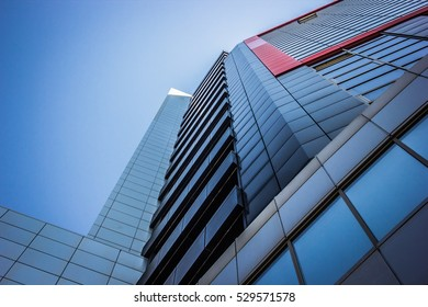 Skyscrapper building on a blue sky background. Steel and glass.