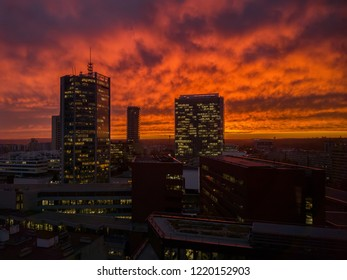 Skyscrappers with orange sky. Doom mood. Apocalyptics images of modern city. Sky in fire.
