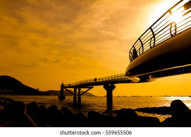 Sky-walk in to the sea on background mountain and boat transport.