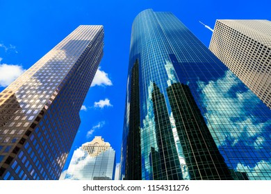 Skyward view of modern downtown skyscrapers.
