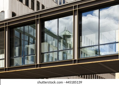 Skyways connecting buildings. Looking up at glass walkways in an urban setting.