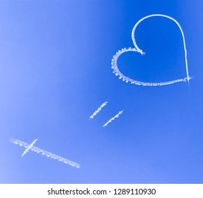 Skywriting against a bright blue sky, written above Sydney, NSW, Australia. The message states that a crucifix - representing Christianity or God or Satan perhaps - equals love...debatable of course!