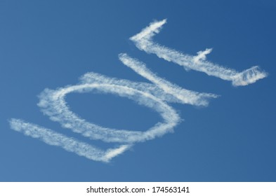 A skywriting airplane writing LOVE in the sky