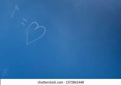 Skywriting at Easter with Jesus is love symbols on a blue sky