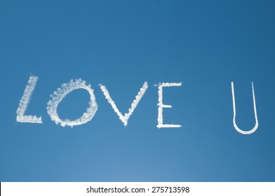 Skywriting Love you in blue sky with sun nearby