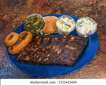 Slab of meat and sides on a table at famous bbq restaurant in Memphis, Tennessee