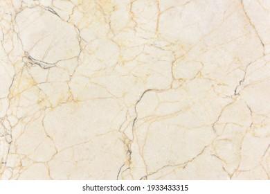Slab of smooth, light veined marble.