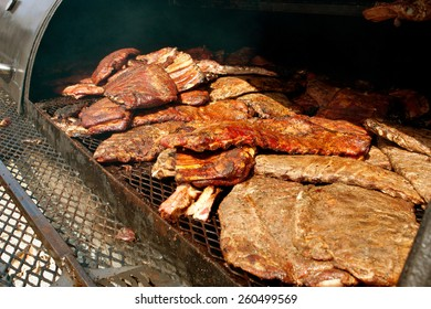 Slabs Of Ribs Barbecue On Grill At Festival