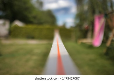 Slack Line setup and ready to go. Focus on the center of the line, and breath. Balance is everything in this image, and the colours of Spring are present in the entire image.