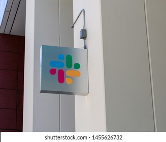 Slack logo on facade of software company headquarters building - San Francisco, California, USA - July 12, 2019